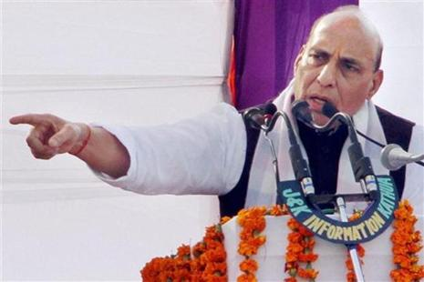 Union home minister Rajnath Singh addresses during a function to honour the families of martyrs of security forces at Kathua, 80 km from Jammu on Sunday. Photo: PTI
