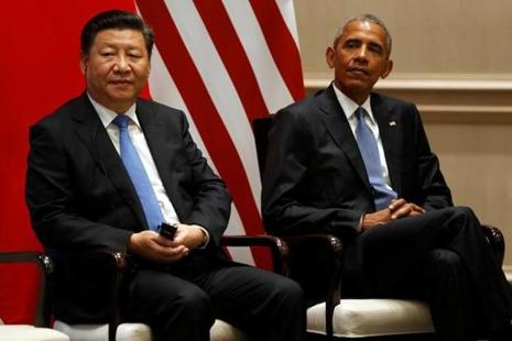 China's President Xi Jinping (left) and US President Barack Obama during Paris summit. Photo: Reuters