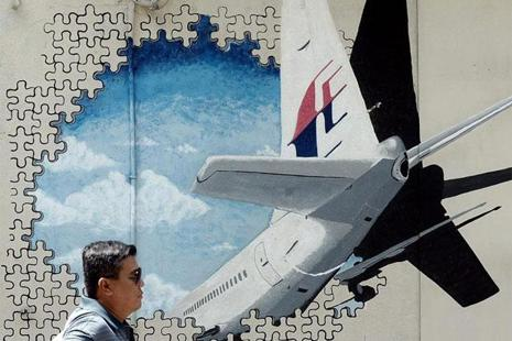 A file photo of a mural of the missing Malaysia Airlines MH370 plane in a back-alley in Shah Alam. Photo: AFP