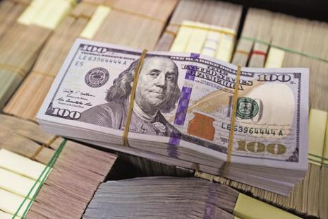 A stronger dollar and expectations of better economic growth in the developed world has led to a flight of capital to dollar-backed assets. Photo: Reuters