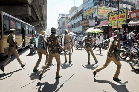 Policemen lathicharge protesters who were holding a protest demanding permanent solution to hold Jallikattu. Photo: PTI
