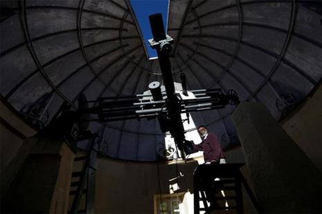 Devendran P. with the six-inch telescope at the Kodaikanal Solar Observatory. Photo: Reuters