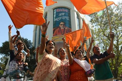 Shiv Sena party workers take part in a rally after victory in the BMC election in Mumbai on Thursday. Photo: AFP