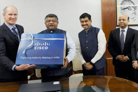 Union minister Ravi Shankar Prasad (2nd L) with Cisco VP (supply chain operations) John Kern at the launch of the Cisco's first set of 'Make in India' products, in New Delhi, on Thursday. Photo: PTI