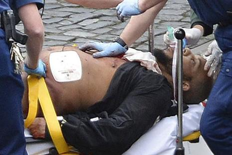 The London attacker Khalid Masood being treated by emergency services outside the UK Parliament on Wedesnday. Masood was once investigated by MI5 intelligence officers over concerns about violent extremism. Photo: AP
