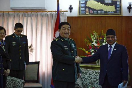 Nepalese Prime Minister Pushpa Kamal Dahal, also known as Prachanda, shakes hand with Chinese defence minister Chang Wanquan during a meeting at the prime minister's official residence in Kathmandu, Nepal. Photo: Reuters