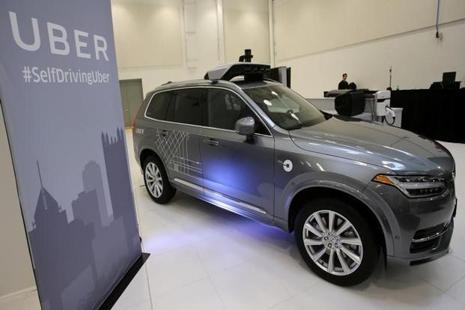 Self-driving Uber vehicles always have a driver who can take over the controls at any time. Photo: Reuters