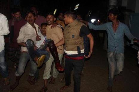 A wounded man is taken to a hospital by local people after a bomb blast in Sylhet, Bangladesh, on Saturday. Photo: Reuters