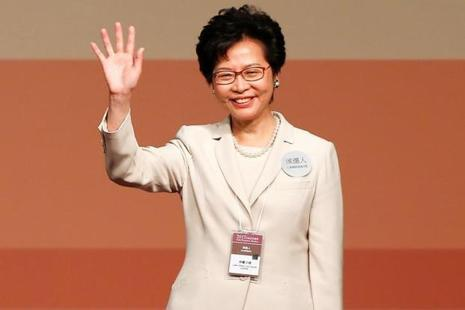 Carrie Lam waves after she won the election for Hong Kong's chief executive in Hong Kong, China, on Sunday. Photo: Reuters