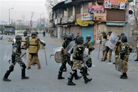 Security forces rush to the spot where militants ambushed police officers at Padgampora in Pulwama district of south Kashmir on Sunday. Photo: PTI