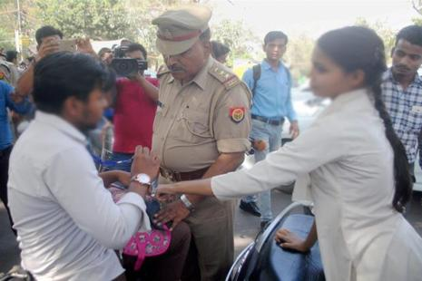 Anti-Romeo squad of police, ordered by UP chief minister Yogi Adityanath, hauls up a youth in Lucknow on Wednesday. Photo: PTI