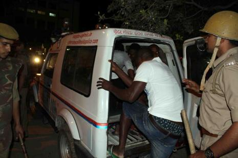 Greater Noida police transporting African nationals during a violent rampage by local residents following death of a local teenager from a suspected drug overdose. Photo: AFP