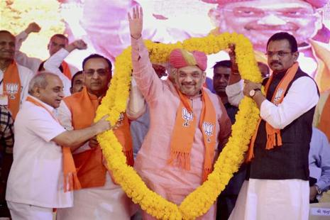 BJP national president Amit Shah being garlanded by Gujarat CM Vijay Rupani, Dy CM Nitin Patel and state BJP chief Jitubhai Vaghani at Sabarmati riverfront in Ahmedabad on Wednesday. Photo: PTI