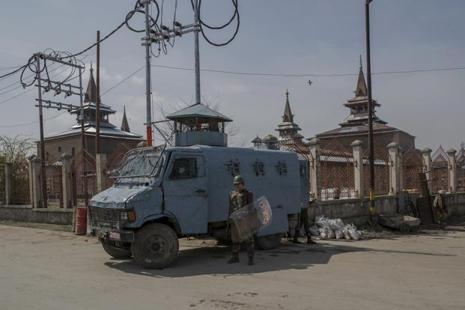 Paramilitary soldiers stand guard during a strike in Srinagar on Wednesday after separatists called for a strike after the death of three civilians on Tuesday. Photo: AP