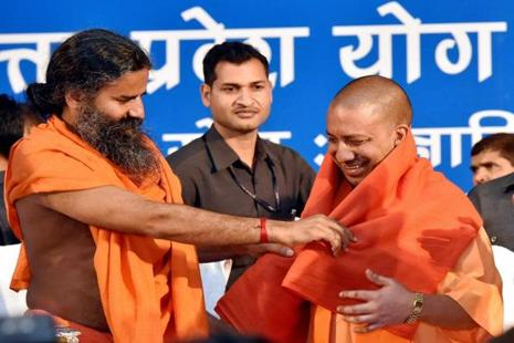 Uttar Pradesh chief minister Yogi Aditiyanath (right) is felicitated by Baba Ramdev during Yoga Mahotsav in Lucknow on Wednesday. Photo: PTI