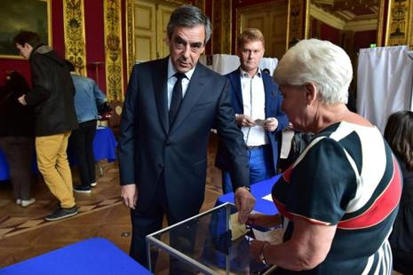 French presidential election candidate for the right-wing Les Republicains (LR) party Francois Fillon casts his ballot at a polling station in Paris, on 23 April, 2017.  Photo: AFP