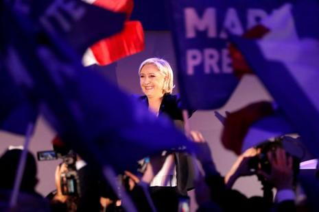 French presidential candidate Marine Le Pen celebrates after early results in the first round of 2017 French presidential election in France on Sunday. Photo: Reuters.