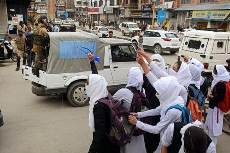 Girl students shout slogans during clashes with security personnel in the vicinity of Lal Chowk in Srinagar. Photo: PTI