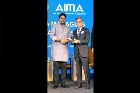Pawan Munjal, CMD & CEO, Hero MotoCorp, receiving the Indian MNC of the Year Award, from Union minister Babul Supriyo at the AIMA Awards. Photo: PTI