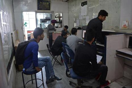 Kashmiri men in an internet cafe in Srinagar. The Internet shutdown in Jammu and Kashmir has hit doctors who treat rural patients via WhatsApp, and silenced journalists covering Kashmir protests. Photo: Tauseef Mustafa/AFP