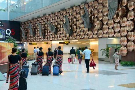 As passengers arriving at an airport feel frustrated when made to wait for their luggage, airports have experimented with increasing the distance between gates and baggage claim areas so that passengers would spend time walking instead of waiting for their luggage.Ramesh Pathania/Mint