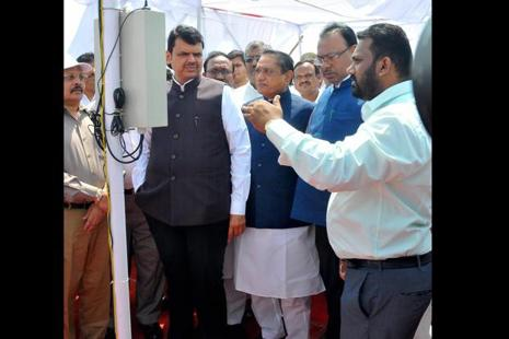 Maharashtra CM Devendra Fadnavis along with other ministers launches 'Mahavedh' project of to set up automatic weather stations in all 2,065 revenue circles across the state, from Dongargaon in Nagpur district on Sunday. Photo: PTI