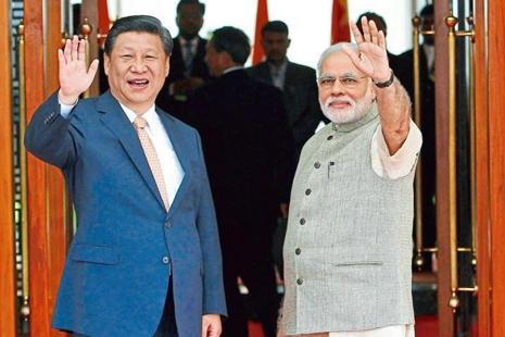 China President Xi Jinping and India PM Narendra Modi. Photo: Amit Dave/Reuters