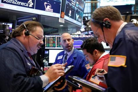 The Dow Jones Industrial Average rose 68.11 points to 20,872.95, the S&P 500 gained 8.04 points to 2,389.77 and the Nasdaq Composite added 33.64 points to 6,117.35. Photo: Reuters