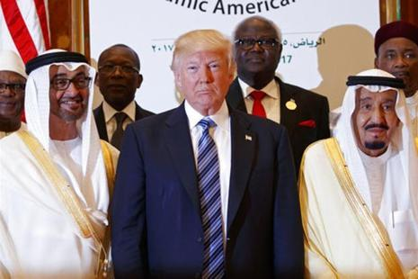 Donald Trump signed a $110 billion arms sale to Saudi Arabia that put him firmly on one side of the sectarian divide fuelling most of the Middle East's wars. Photo: AP