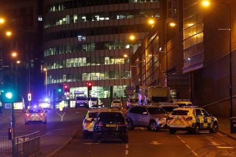Vehicles are seen near a police cordon outside the Manchester Arena, where US singer Ariana Grande had been performing, in Manchester, Britain on 23 May. Photo: Reuters