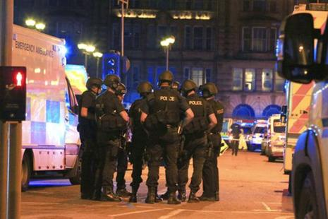 Armed police gather at Manchester Arena after reports of an explosion at the venue during an Ariana Grande concert in Manchester. Photo: AP