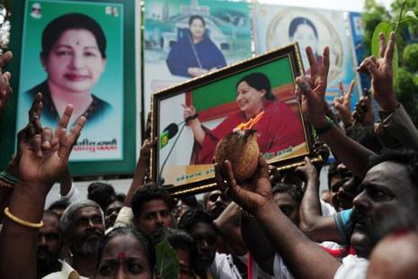 A file photo of AIADMK supporters celebrating in front of J. Jayalalithaa's residence in Chennai. Photo: AFP