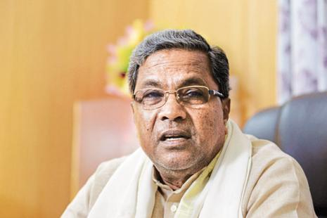 A file photo of Karnataka chief minister K. Siddaramaiah. Karnataka will forgo around 60% of the existing taxes, including entry tax, central service tax, VAT, entertainment tax, betting tax and luxury tax—totaling about Rs35,000 crore annually—as they will be subsumed by the GST.  Photo: Mint