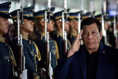 Philippines President Rodrigo Duterte walks past honour guards as he arrives at Manila international airport, after returning from a visit to Russia. Photo: Noel Celis/AFP