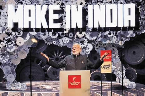 PM Narendra Modi promoting Make in India at the Hannover Messe industrial technology fair in 2015. The Union Cabinet's national procurement policy will give a fillip to local manufacturing and jobs growth in the services sector. Photo: Reuters