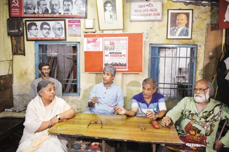 Former Naxalite leader Gouri De with Charu Majumdar's son Abhijit Majumdar, (third from right) and other CPI(ML) supporters at the party office in Siliguri.  Photo: Indranil Bhoumik/Mint