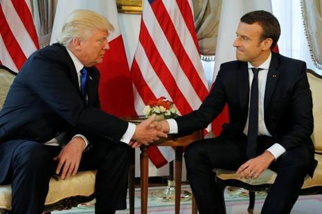 US President Donald Trump shakes hands with French President Emmanuel Macron during a meeting at the US Embassy in Brussels on 25 May. Photo: Reuters