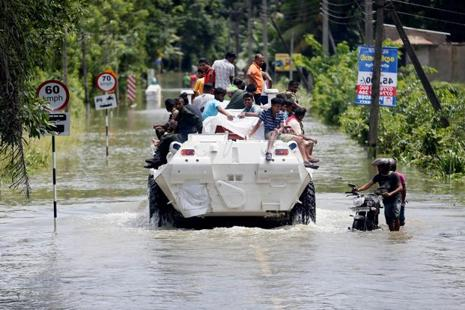 The Sri Lankan military used large armoured vehicles and boats to transport people to safety. But some remained trapped in interior villages where boats have been unable to reach. Photo: Reuters