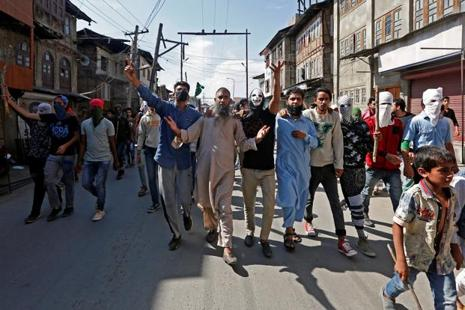 Demonstrators shouting slogans during a protest in Srinagar on Saturday. Photo: Reuters
