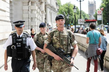 British police said they had arrested a 14th person in connection with the Manchester suicide bombing, and were searching a property in the south of the city. Photo: Bloomberg