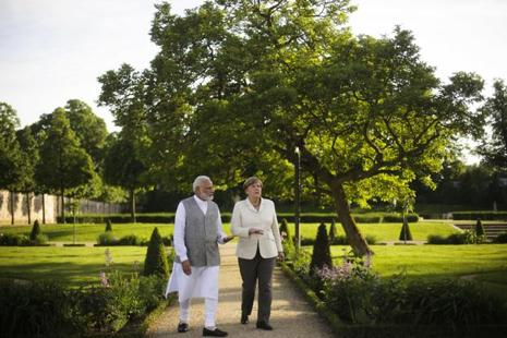 German Chancellor Angela Merkel (right) and Prime Minister Narendra Modi, walk through the garden of the government guest house Meseberg Palace during a meeting in Meseberg, on Monday. Photo: AP