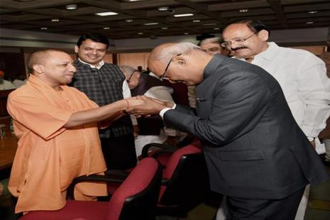 UP chief minister Yogi Adityanath (far left) greets NDA presidential candidate Ram Nath Kovind in New Delhi on Friday. Photo: Subhav Shukla/PTI