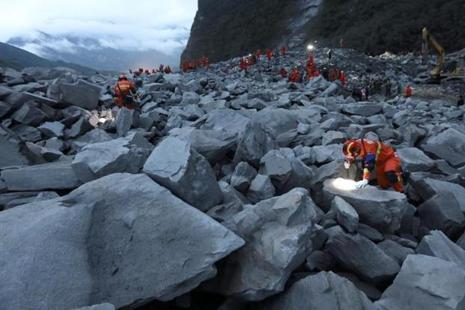 Dozens of homes were buried when the landslide hit Xinmo village. Photo: Reuters