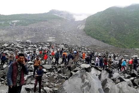 People search for survivors at the site of a landslide that destroyed some 40 households, in Xinmo Village of Sichuan Province in China on 24 June. Photo: Reuters
