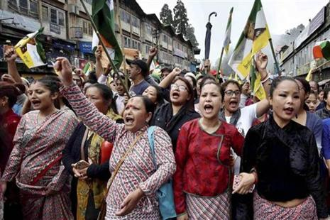 People raise slogans as they participate in a mass rally to demand for a separate state of Gorkhaland in Darjeeling on Saturday. Photo: PTI