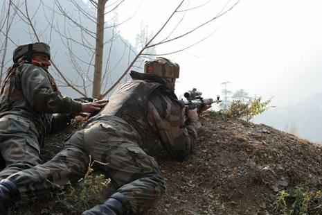Indian Army troops during search and sanitation operations, recovered the body of a member of the BAT team along the LoC in Jammu and Kashmir's Poonch district on 22 June. Photo: AFP