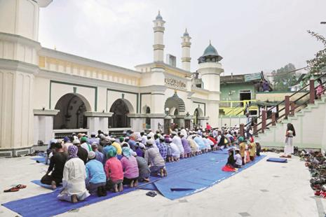 Muslims pray at Anjum-E-Islamia mosque in Darjeeling on Monday. About 1,500 turned up for namaz, unlike in past years when 5,000-odd would pray at the mosque on Eid. Photo: Saibal Das/Mint