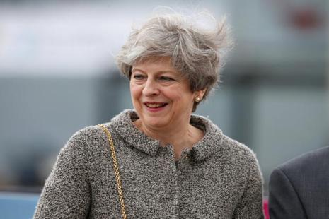 UK Prime Minister Theresa May is hoping to wrap up the DUP agreement early this week, because she faces votes on her program and any amendments on Wednesday and Thursday. Photo: Reuters