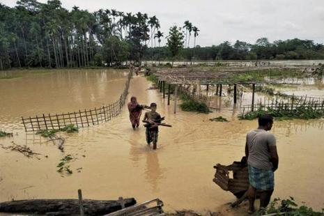The eight flood-hit districts in Assam are Lakhimpur, Jorhat, Karimganj, Karbi Anglong, Hojai, Golaghat, Sivasagar and Sonitpur overrunning 150 villages in nine revenue circles. Photo: PTI