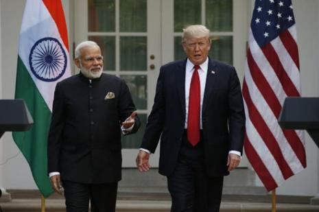 US President Donald Trump arrives for a joint news conference with Prime Minister Narendra Modi (left) in the Rose Garden of the White House in Washington. Photo: Reuters